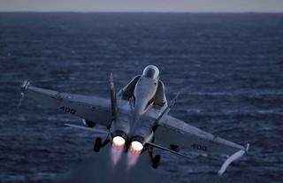An F/A-18C Hornet launches.