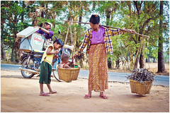 Iceman on the road to Mt. Popa (electrigger) Tags: woman ice kid child basket burma femme icecream iceman myanmar vendor burmese birma seller taung zin birmanie birmanne