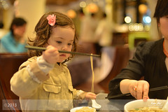 Chopstick Artistry (Lao An (PhotonMix)) Tags: china girl kids dinner 50mm nikon asia dof bokeh chopsticks noodles d800 eatingwithchopsticks mixedethnicity