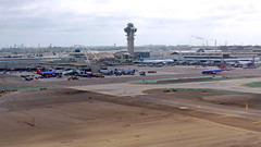 LAX ( Slices of Light   ) Tags: california usa plane lumix la los airport pacific angeles terminal panasonic landing international lax airborne cathay lf1