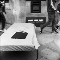 OXCAT Spreads Awareness About Human Trafficking (David Stumpp |[o]| Photography) Tags: street uk greatbritain light england people bw white podcast black 120 6x6 tlr film monochrome rolleiflex zeiss photoshop square photography daylight focus day natural unitedkingdom tmax human oxford carl epson barrier mf manual grayscale activism slavery oxfordshire choreography activists available nationalgeographic planar twinlensreflex 125 oxon 80mm cordon kodaktmax cornmarket fp4plus fpp creativesuite 28f antislavery v500 carfaxtower humantrafficking cs6 photoscanner filmphotographyproject wwwdavidstumppcom thelunchtimeportraits oxcat