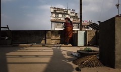 A women standing next to the view and sentimentally cleaning, Kathmandu, Nepal. (SUNA_PHOTOGRAPHY) Tags: street nepal sunset shadow people colour building nikon mask kathmandu dust nepali