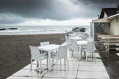 Tavolini (Vanda Guazzora) Tags: autunno sedie lungomare spiaggia abbandono misano