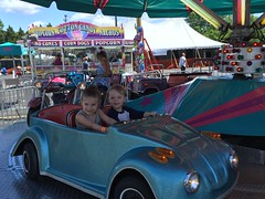 """Paul and Inde Ride the Cars at the Rose Festival • <a style=""""font-size:0.8em;"""" href=""""http://www.flickr.com/photos/109120354@N07/27821828066/"""" target=""""_blank"""">View on Flickr</a>"""