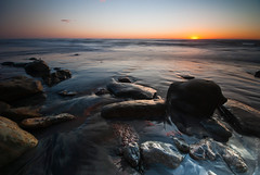 Sunset (Walter B) Tags: ocean california longexposure travel sunset reflection landscape nikon rocks waves pacific sandiego tide dogbeach d40x coastalphotography