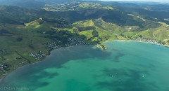 Flying (Dylan Farrow) Tags: blue sea newzealand beach window landscape flying air flight pixelpost flickrpost whangapoua 60d