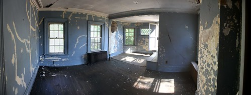 Peeling paint and crumbling plaster in the master bedroom