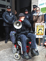 P2134677 DPAC DWP (Lo Res) (pete riches) Tags: uk london dan protest police flags demonstration solidarity pip posters unions banners activists civilrights dwp protesters disabilityrights slogans ica placards atos pamphlets ukpolitics leaflets rnid wca madpride rnib dla metpolice atosorigin austerity rtwc dpac disabilitylivingallowance workfare cescr economicsocialandculturalrights caxtonhouse righttoworkcampaign ihoops rightsofpersonswithdisabilities mariamillermp disabledpeopleagainstcuts taraflood hardesthit disabledactivistsnetwork winvisible lindaburnip workcapabilityassessment disabilitybenefit invalidcarersallowance madnetwork atoskills personalindependentpayments hammersmithandfulhamcoalitionagainstcommunitycarecuts hafcac unitednationsconvention unitednationsinternationalcovenant protestprotestprotestersdemonstrationdemonstrationdemo2012demonstratorsactivistscampaignersbannersplacardsslogansflyersleafletspamphletslondonactivismsolidaritypolicemetpolicepolice metpolicedpacdpacdisabledpeopleagainstcutsdandisabledactivistsnetworkmadnetworkmadpridewinvisibledwpicainvalidcareallowancedladisabilitylivingallowancewcaworkcapabilityassessmentpippersonalindependencepaymentindependent