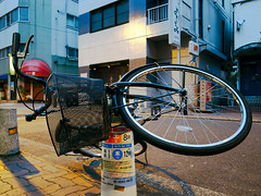 Do you mind if I hang my bike here? (paradoxbox) Tags: bike bicycle tokyo basket iii parking bad fallen hanging ricoh nippori nishi mamachari grd