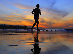 Sunset Runner (peasap) Tags: blue winter shadow orange beach sports silhouette clouds reflections evening pacific running run lajolla shore athlete jogging triathlon jog
