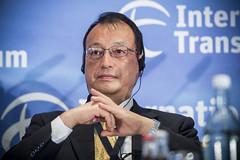 Tetsuo Akiyama listens to the presentations.