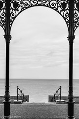 this way to the seaside. (Patrick Mayon) Tags: england bw seascape monochrome architecture landscape kent iron arch meetup steel symmetry nb angleterre paysage hernebay symtrie londonflickrmeetup ferforg Meetup:eventid=866222