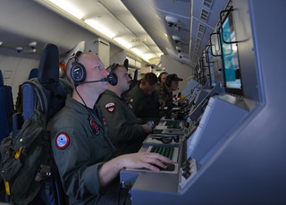 The U.S. Navy helps search for Malaysia Airlin...