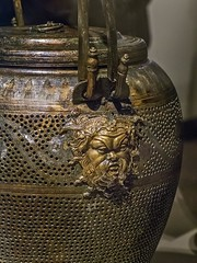 Closeup of a finely crafted head of the god Pan on an ornate bronze Lychnouchos (Lantern) from the tomb of King Philip II of Macedon Greek 336 BCE (mharrsch) Tags: chicago lamp bronze greek illinois ancient god tomb royal exhibit burial 4thcenturybce pan lantern mythology deity symposium funerary perforated macedon thefieldmuseum philipii thegreeks mharrsch thegreeksagamemnontoalexanderthegreat
