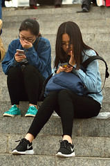 Phone Addicted (katushang) Tags: life china street city urban girl heilongjiang river daylight 85mm mobilephone  dslr riverbank fareast harbin helios dx haerbin songhuajiang helios402 songhuariver   russianlens 85mm15 streetpotraits d5100 d5100 fxlensondxcamera fullframelensoncropsensor fxlensonadxcamera helios402n
