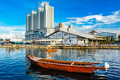 a boat and a towers (Irwin Day) Tags: muara karang angke