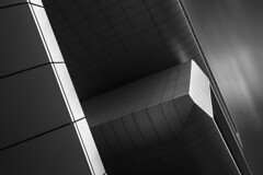 ROC Leiden (RhoeLLL) Tags: light blackandwhite abstract building monochrome lines architecture modern clouds dark long exposure graphic nederland lookingup bnw blacksky archilovers