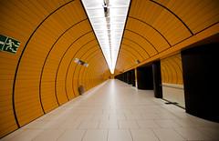On The Phone (Pamela Marklew) Tags: orange underground subway munich mnchen tiles ubahn marienplatz