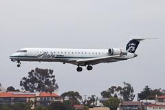Alaska Airlines (SkyWest Airlines) Bombardier CRJ-701ER N227AG (jbp274) Tags: airport san cloudy airplanes oo crj alaskaairlines bombardier lindberghfield skywest ksan