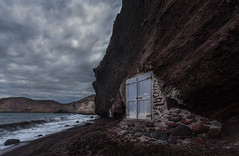 A door on the sea cliff  (kaising_fung) Tags: door sea cliff beach shore cave