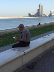 Reading, Al Khan, Sharjah (Mayur Kakade) Tags: street people reading uae elderly sharjah cornish stevemccurry alkhan lostinmoment
