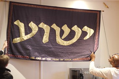 Readying the banner/ wall (bobmendo) Tags: thanksgiving evening banner hebrew yeshua jewsforjesus jfjaustralia