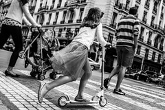Street - Riding a scooter (Franois Escriva) Tags: street blue light sky people bw sun white black paris france girl parents noir dress ride candid streetphotography scooter olympus nb blanc omd trotinette patinette