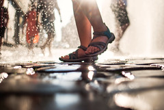 297/365 Splash (ewitsoe) Tags: street urban mist reflection feet wet water misty 35mm living cityscape play image sandals crowd citylife polska spray cobblestones 365 peopel watery coolingdown nikond80 ewitsoe