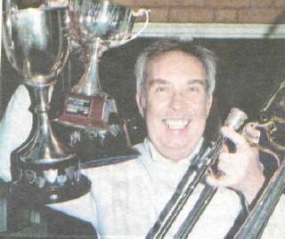 2001 : scaba contest prizes: Colin Batt receives trophys for Best Trombone Section & 3rd Place for contest piece