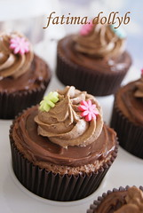 Chocolate and Flowers... :) (fatima.dollyb) Tags: flowers brown baking chocolate cupcake icing bakers deathbychocolate ganche fatimadollyb