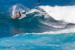 Surfer - Oahu, Hawaii (The Web Ninja) Tags: world ocean travel travelling tourism sports water sport canon photography eos hawaii photo surf waves photographer oahu surfer explorer wave surfing tourist adventure explore surfboard destination honolulu explored surfed t2i canonrebelt2i ashleiggh