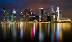 Singapore City Skyline at Blue Hour (David Gn Photography) Tags: city longexposure travel panorama reflection tourism water skyline night skyscraper marina hotel evening bay singapore raw cityscape dusk landmark scene esplanade cbd bluehour centralbusinessdistrict singaporeriver merlionpark canoneos7d sigma2470mmf28ifexdghsm