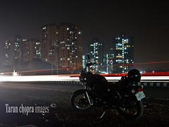 IMG_0090 Thunderbird on the road... (Tarun Chopra) Tags: road india night canon nightshot trails motorbike motorcycle gurgaon longexpose s100 canons100 canonpowershots100 twinsparkthunderbird valleyviewappartments