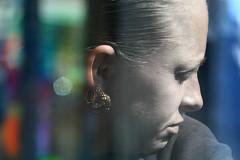window (teldow) Tags: street people woman colour reflection window spring rainbow earrings sunspot teldow
