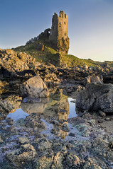 Dunure Castle (Bora Horza) Tags: ocean sunset sea sun lake reflection castle abandoned water architecture sunrise mirror golden coast scotland twilight waterfront fort citadel ruin medieval historic reflect forgotten restored kennedys loch fortification stronghold fortress castello chteau goldenhour burg castillos maintained renovated ayrshire dunure mackinnons dunurecastle   abandonedscotland carrickcoast dunoure