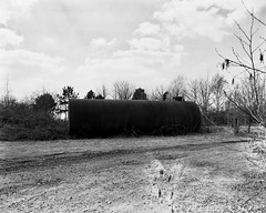 Greenham Common Negative Scan Fuel Tank (Rebecca Sharplin Hughes) Tags: white black abandoned mamiya film field army infrared medium format common derelict newbury nato airfield rb67 greenham film:iso=400 developer:brand=agfa film:brand=rollei agfar09oneshot developer:name=agfar09oneshot rolleiinfraredir film:name=rolleiinfraredir400 filmdev:recipe=8414