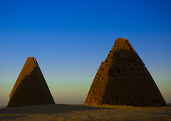 The Pyramids At Jebel Barkal, Used By Napatan Kings, Karima, Sudan (Eric Lafforgue) Tags: africa travel blue sunset sky history archaeology cemetery horizontal architecture outdoors photography sand ancient day desert pyramid northafrica soedan african sudan tomb dry sunny bluesky unescoworldheritagesite mausoleum copyspace ancientcivilization nubia thepast karima oneperson clearsky ruined soudan tranquilscene saharadesert northernafrica traveldestinations colorimage famousplace meroitic fulllenght oldruin aridclimate  1people szudn sudo jebelbarkal  northernsudan placeofburial northsudan blackpharaohs     kushitic  xuan eri7259