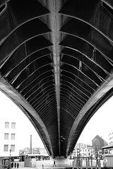 Under the Footbridge (Just Ard) Tags: street bridge venice blackandwhite bw man blancoynegro monochrome lines photography 50mm mono nikon noiretblanc zwartwit candid underside d750 unposed  span biancoenero schwarzundweis justard