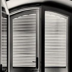 Morning light (stendol [L.B.W.L.]) Tags: door morning light window blackwhite shadows ombre finestra persiana porta luci sole bianconero mattina composizione attraverso mattutino spiragli chiaroscuri