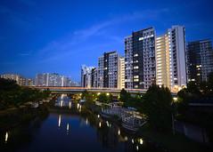 HDB Blocks (MarPa87) Tags: light sky house reflection water architecture night clouds skyscraper dark singapore punggol highrise hdb