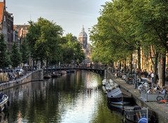 Canal in Amsterdam (neilalderney123) Tags: church water amsterdam river landscape boats canal olympus omd 2016neilhoward