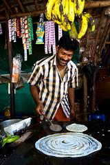 Banana pancake (Kerala, India 2012) (slawekkozdras) Tags: travel food india man cooking shop circle person kerala banana pancake munnar