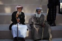 Omani men (Mayur Kakade) Tags: old travel portrait people man men 35mm photography duo islam middleeast arab age sword stick oman muscat 2012 whitehair beared salalah omani muscatfestival f18g araibic