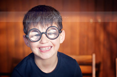 And now give me a smile - The portrait series 2012 - 05 (*Marta) Tags: carnival boy portrait smile face smiling fun glasses kid funny child marta
