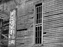 Post-campaign Dedication (VFR Photography) Tags: wood windows bw signs texture abandoned broken church window glass sign blackwhite wooden peeling open tn adams tennessee empty political politics churches panes southern frame weathered boardedup thesouth rippled siding pane derelict clapboard decaying dilapidated textured weatherbeaten campaignsign doublehung campaignsigns robertsoncounty countyexecutive boardedover emersonmeggs trustworthdedicated
