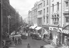 Grafton Street (National Library of Ireland on The Commons) Tags: ireland horse dublin fish cars ford caf restaurant carriage traffic bicycles lamppost 1940s poultry shops pedestrians builders dalek shamrock woolworths graftonstreet forties automobiles tearooms mcconnells chemist leeches decorators plumbers electricians leinster ingersoll motorists medicalsupplies chathamstreet nationallibraryofireland fitters surgicalsupplies messengerboy fanninco fordsuperdeluxe monumentcaf rileyconvertible valentinecollection valentinesons fordangliae04a zc8215 zd6822 zd9822 ih4480 greggschoolsltd jfkeatingesons