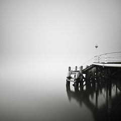 Terminus (Andy Brown (mrbuk1)) Tags: ocean longexposure shadow mist seascape reflection water fog contrast square mono pier blackwhite wooden jetty fineart eerie minimal negativespace lamppost devon torquay simple ghostly railings tone timbers nd110 silverefexpro notasdarkasmostidoalthoughthatshadowyoumaynotlikeisprettyclose