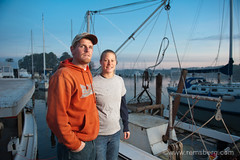 Young watermen couple standing on dock before tonging for oysters at the mouth of the Patuxent river on Chesapeake Bay (Remsberg Photos) Tags: usa boat fishing fisherman transport harvest maryland ag seafood oyster agriculture fishingboat tong waterman chesapeake dredge mollusk workboat watervehicle watermen solomansisland agriculturethings