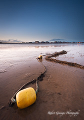 Two Buoys (Rob Grainger) Tags: sunset sea seascape reflection beach yellow twilight sand nikon filter lee clacton f28 buoy martello beachscape buoyant 1424mm sw150 yearend13