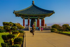 In the wind! ( In 2 Making Images | L.A.) Tags: california trees sky people usa mountain plant horizontal architecture outdoors temple design losangeles day bell religion windy bluesky railing southkorea sanpedro greengrass absence traveldestinations colorimage famousplace kidsrunning koreanculture koreanbelloffriendship builtstructure canoneosdigitalslr discoverla rebelt2i albertvalles
